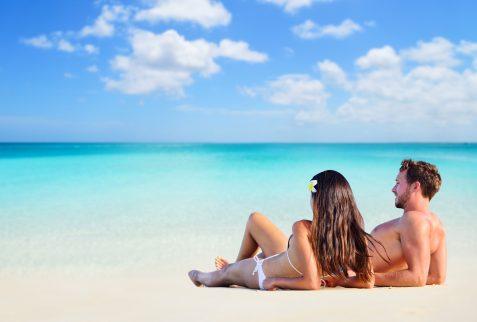 Whitsunday island tours Whitehaven Beach tours. Romantic couple